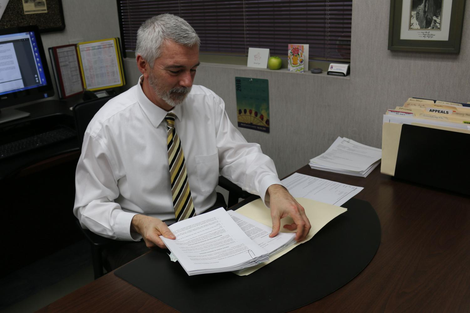(CAM MEDRANO/EYE OF THE TIGER)  RJUHSD executive director of Personnel Services Brad Basham works in his office. Basham said tenure has the ability to impede district disiplinary action.