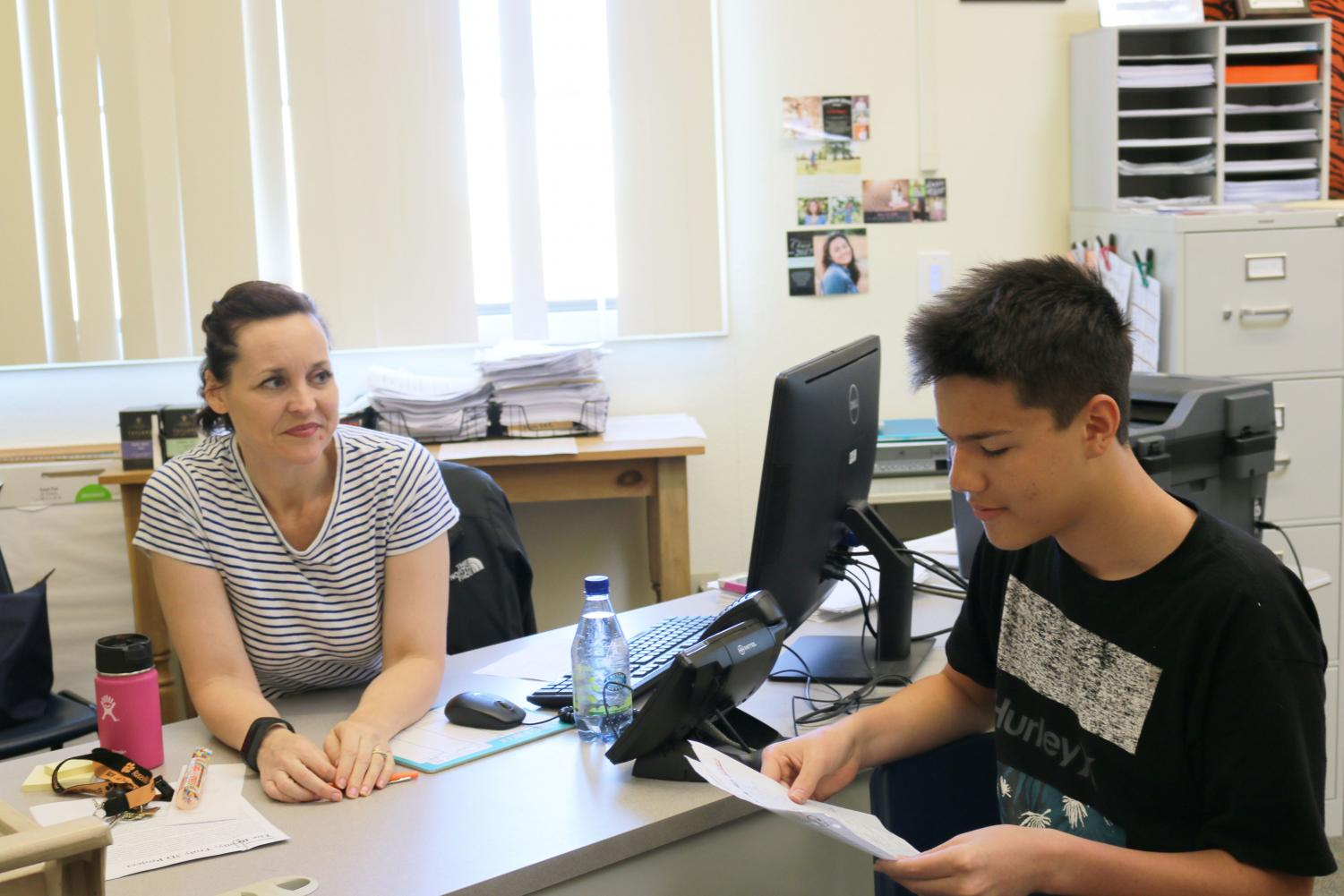 (NICOLE KHUDYAKOV EYE OF THE TIGER)  Josh Briscoe frequents French teacher Amy Mowrer's classroom, where he recieves advice on his conversational skills and analysis of the stories he writes in French.