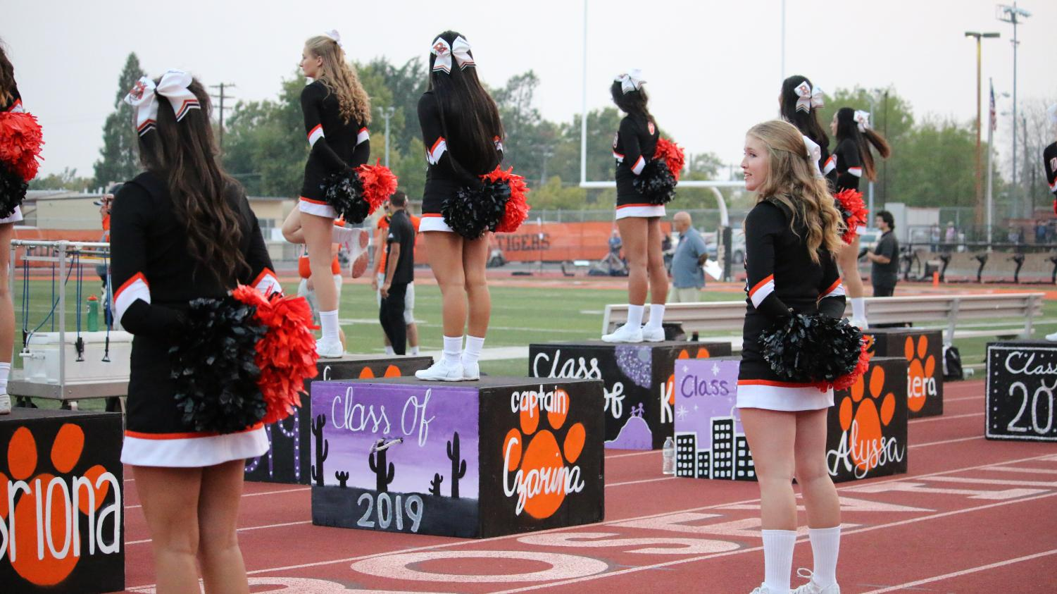 Above, the 2018-19 cheer team at the first home game of the year. The team began the year coachless after 22-year-old cheer coach Gabi Vega was arrested for DUI with students in the vehicle. They have since replaced Vega after two months without a coach.