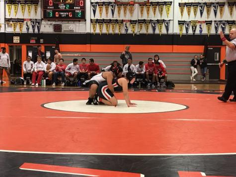 Junior Gabby Supapo began playing wrestling this year after being cut from the girls varsity basketball team. Despite this setback, Supapo continues to find support from her fellow teammates and mother, another former wrestler.