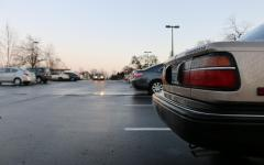 Students park in the parking lot on Berry Street south of Independence High School. Over winter break 21 additional parking spaces were striped along with the removal of vehicles and containers that were being stored on the lot.