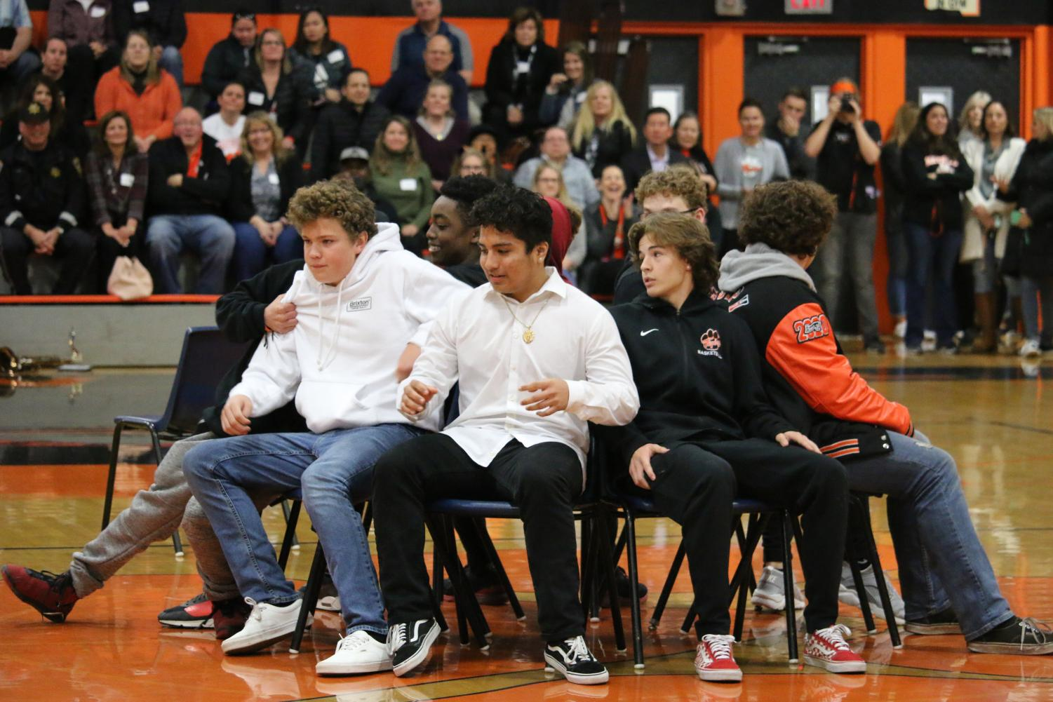 Students+from+various+grades+compete+in+musical+chairs+at+the+Casaba+rally.+
