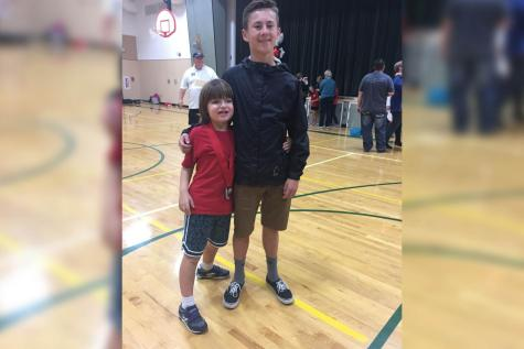 Kyle Barns works with young athlete, Ryder Rudgers, to overcome his disabilities. According to Rudgers's mother, Barnes and Rudgers have made large strides in crushing his disabilities.