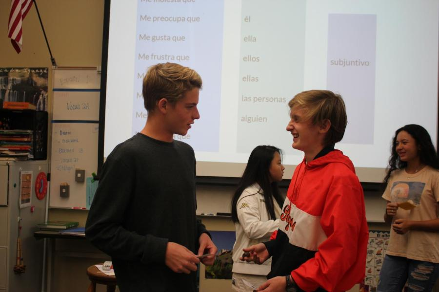 Right, junior Shane Meadows-Yaw practices his language skills during a speaking exercise in Spanish 4. Meadows-Yaw was one among two students who travelled to Spain this summer.