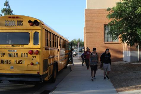 Above, students arrive for school to start class at 7:40. California high schools are required to move start times back to 8:30 or later by 2022.