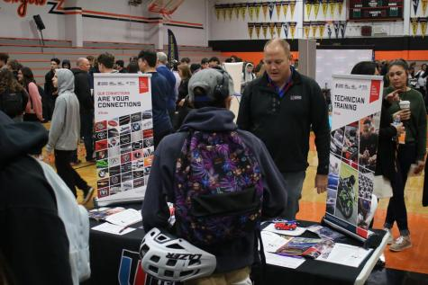 A student learns more about UTI technician training at the annual RHS career fair.