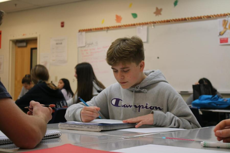 Sophomore Riley Griffin works in his second period Honors English 10 class. Griffin believes restorative circle sessions have been beneficial for the RHS community.