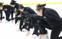 Freshman Caty Sergent keeps her skates sharp as she slides in formation with the rest of her team. Though this is only a practice, each attempt at learning new choreography takes the utmost concentration.