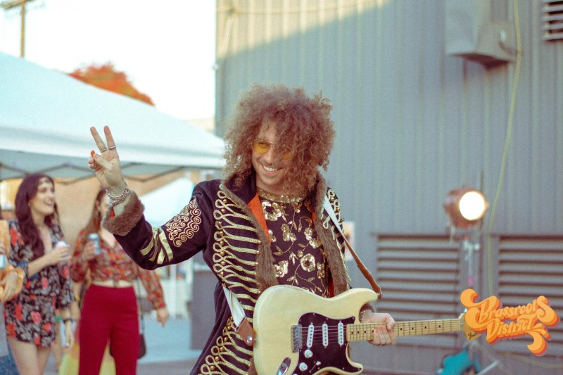 Copper Jones, one of the lead singers of the band, waves hello to his fans.