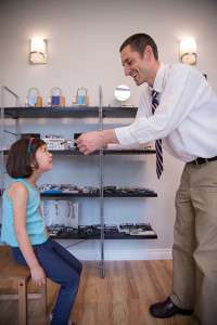 Portland Optometrist fitting eyeglasses on child