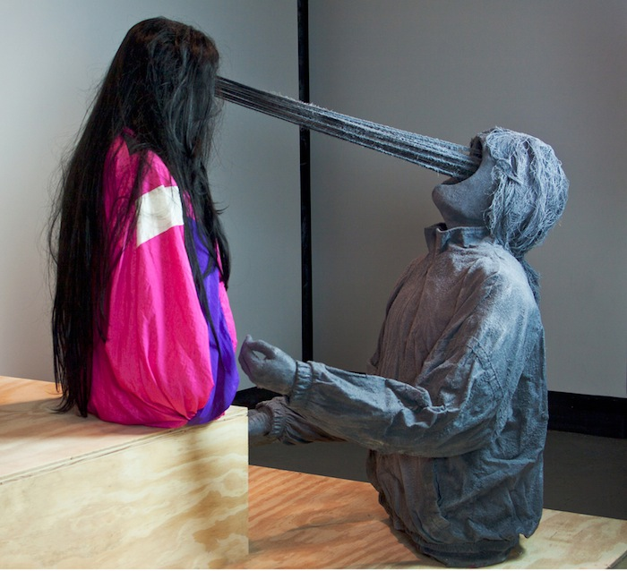 Roxanne Jackson , Title: Don't Stop Believin', 2013 Media: Track jackets, ceramic, wigs, flocking, yarn, cast plaster hands Dimensions: 4 x 3 x 2 feet