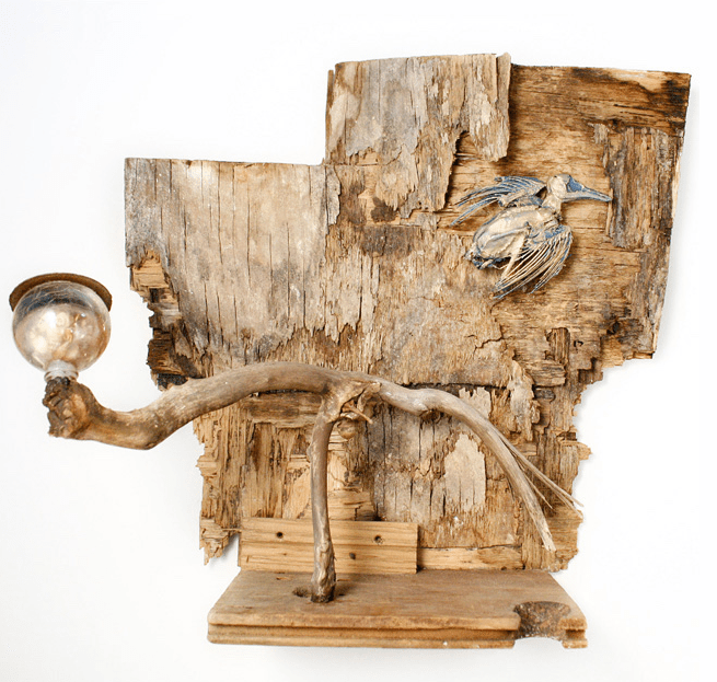 "Going Home, Size -14""h x 14""w x 8""d, 2010, Materials - Detritus/Wood/Tar/Acorns/Glass/Seashells/Mummified Bird/Epoxy/Paint"