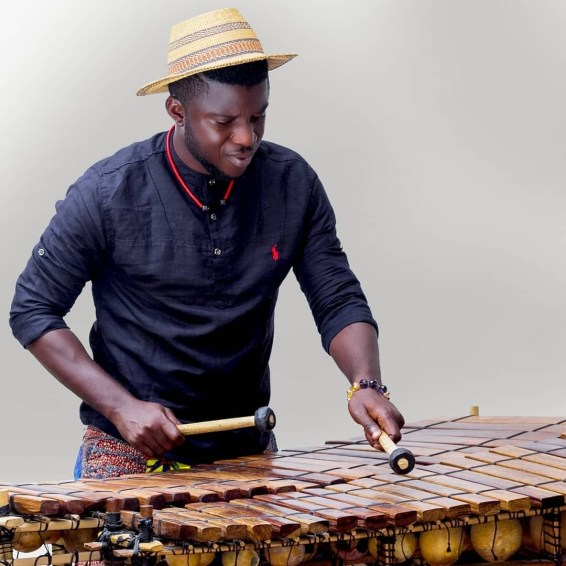 Obase-Aboli in action on his double 22 keys xylophone