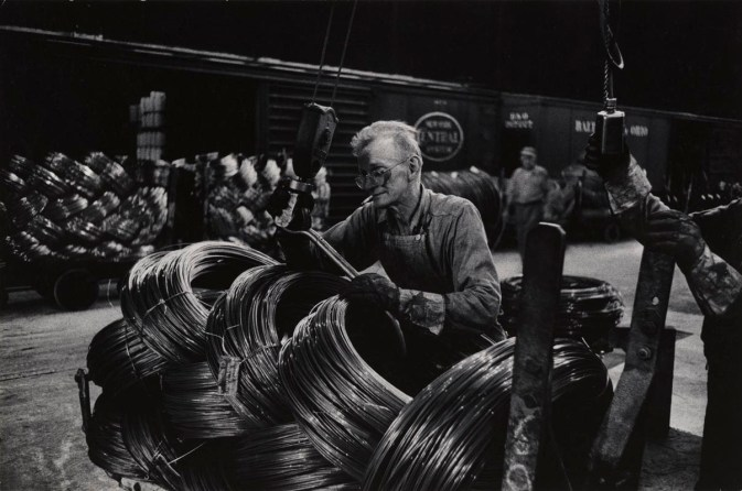 5. Eugene Smith_Mill Man Loading Coiled Steel