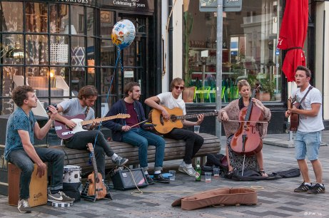 Group of Buskers outside the Mash Tun Pub New Road Brighton street performance UK 2014 eyeteeth.net