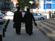 Orthodox Priests in front of Lutheran Church, Bucharest