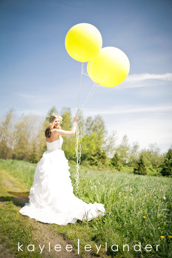 Yellow Huge Balloons In A Fieldwith A Gorgeous Bride