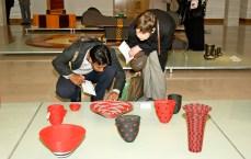 Guests in front of Marisa Fick-Jordaan's Zenzulu Collection.