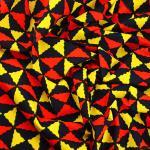 """Tissu Wax Hitarget, motif original """"Millionnaire"""" Orange et Jaune  © Eyrelles Tissus"""