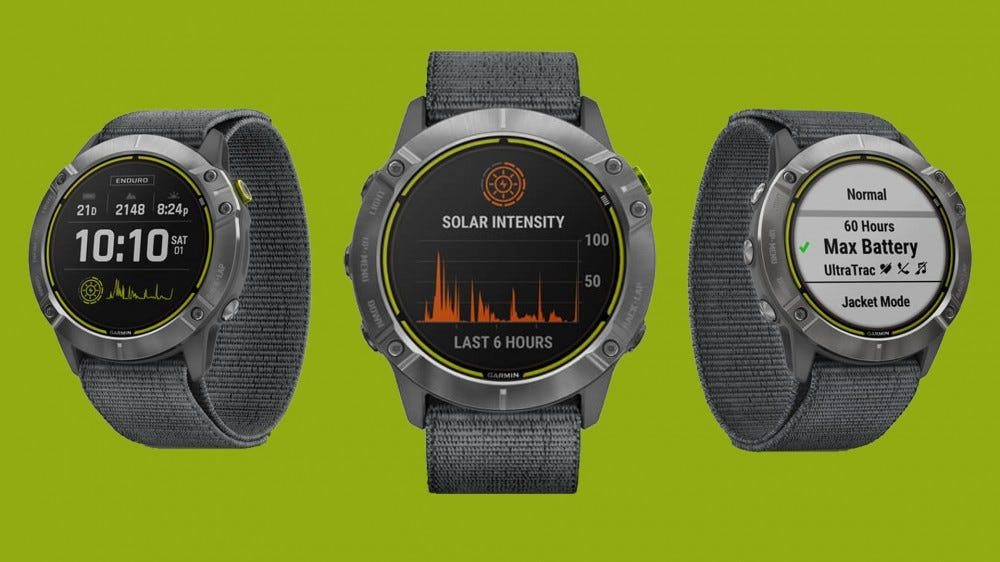 Garmin Enduro GPS watch from left, right, and straight-on views with metrics on display