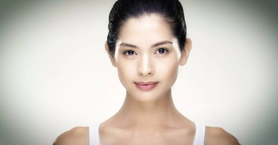 Korean beauty model during a video shoot for a luxury skincare company.