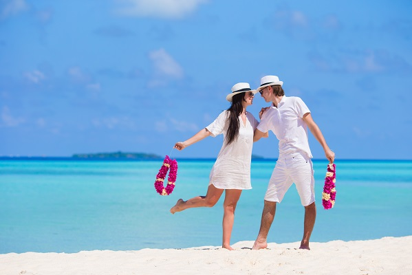 Young happy couple during beach tropical vacation