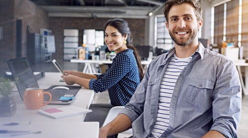 man and woman smiling learning studying myob training courses online