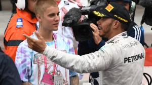 Race winner Lewis Hamilton (GBR) Mercedes AMG F1 and Justin Bieber (USA) in parc ferme at Formula One World Championship, Rd6, Monaco Grand Prix, Race, Monte-Carlo, Monaco, Sunday 29 May 2016. © Sutton Images