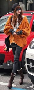 Colors that Go with Orange Clothes   Outfit Ideas   Fashion Rules Orange knitted pullover with black beanie and eggplant boots look courage  and unusually