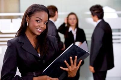Beautiful business woman holding a portfolio