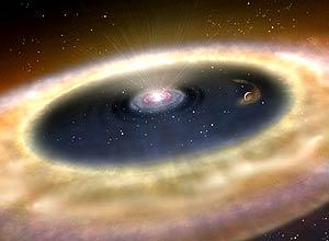 Ilustração artística de como seria a formação de um novo planeta que se encontra a 450 anos-luz da Terra