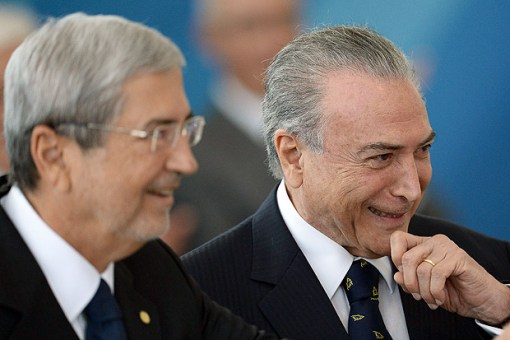 Brazilian President Michel Temer (R) and Chief of Staff Antonio Imbassahy smile during the inauguration ceremony of the ministers of Justice and Public Security, Alexandre de Moraes, of Human Rights, Luislinda Valois and the presidency's Secretary General Wellington Moreira Franco at Planalto Palace in Brasília, on February 3, 2017. / AFP PHOTO / ANDRESSA ANHOLETE