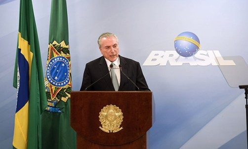 Brazil's President Michel Temer speaks during a press conference following allegations that he gave his blessing to payment of hush money to a politician convicted of corruption, on May 18, 2017 in Brasilia. Temer faced growing pressure to resign Thursday after the Supreme Court gave its green light to the investigation over allegations that he authorized paying hush money to already jailed Eduardo Cunha, the disgraced former speaker of the lower house of Congress. / AFP PHOTO / EVARISTO SA ORG XMIT: ESA105