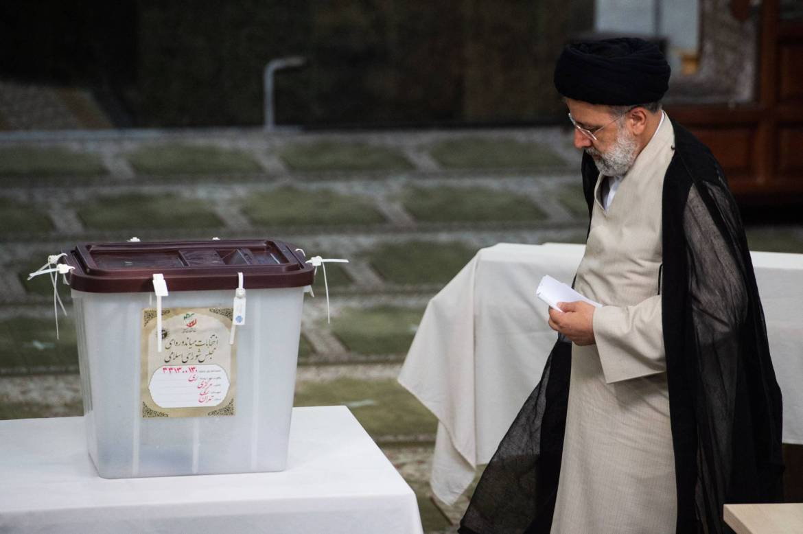 Ebrahim Raisi, Iran's judiciary chief, casts his vote in the country's presidential election in Tehran on Friday. | BLOOMBERG