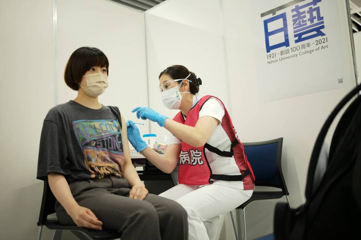 Students at the Nihon University College of Art in Tokyo's Nerima Ward began receiving their first dose of a COVID-19 vaccine on Monday as universities nationwide joined the country's inoculation rollout. | RYUSEI TAKAHASHI
