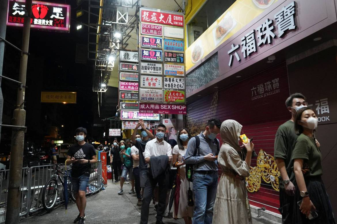People line upto buy copies of the final edition of Apple Daily in Hong Kong on Thursday. | REUTERS
