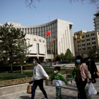 The People's Bank of China headquarters in Beijing. The central bank has said it won't significantly tighten monetary policy, unlike its counterparts in other emerging economies.  | REUTERS
