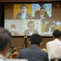 Governors from across the country hold an online meeting on Saturday to discuss COVID-19 measures.  | KYODO