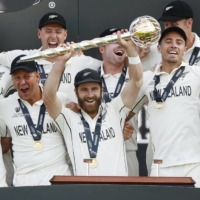 NEW ZEALAND CAPTAIN KANE WILLIAMSON CELEBRATES WITH HIS TEAM AFTER BECOMING THE WORLD TEST CHAMPIONS ON WEDNESDAY.