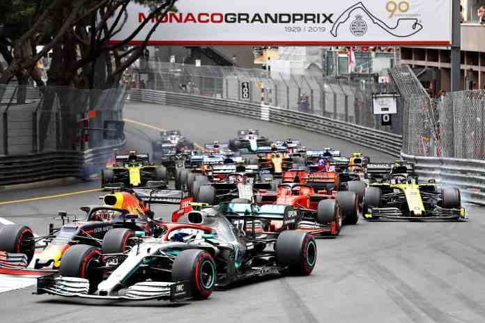 Max Verstappen of the Netherlands driving the (33) Aston Martin Red Bull Racing RB15 and Valtteri Bottas driving the (77) Mercedes AMG Petronas F1 Team Mercedes W10 battle for position at the start during the F1 Grand Prix of Monaco at Circuit de Monaco on May 26, 2019 in Monte-Carlo, Monaco.