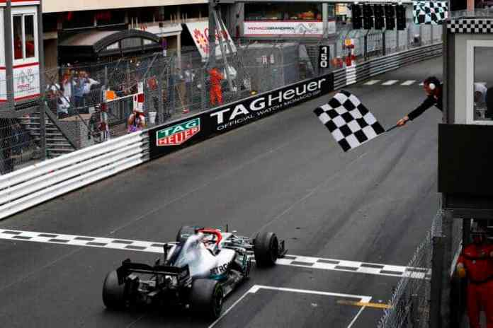 2019 Monaco Grand Prix, Sunday: Lewis Hamilton takes the chequered flag after battling his tyres, and Max Verstappen, for over 60 laps