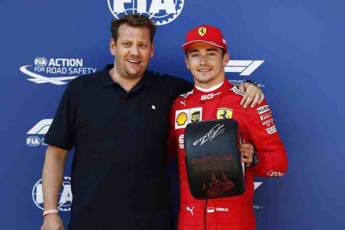 2019 Austrian Grand Prix, Qualifying - Lukas Lauda presents Charles Leclerc with the Pirelli Pole Position Award