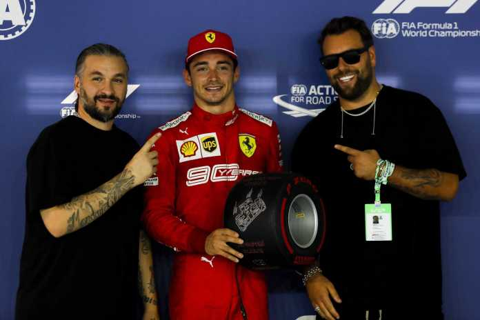 SINGAPORE STREET CIRCUIT, SINGAPORE - SEPTEMBER 21: Pole sitter Charles Leclerc, Ferrari receives the Pirelli Pole Position award from Swedish House Mafia, DJs during the Singapore GP at Singapore Street Circuit on September 21, 2019 in Singapore Street Circuit, Singapore. (Photo by Sam Bloxham / LAT Images)
