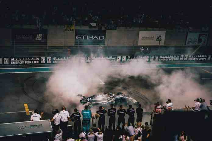 2019 Abu Dhabi Grand Prix, Sunday - Lewis Hamilton celebrates by doing doughnuts at Yas Marina (image courtesy Mercedes-AMG Petronas)