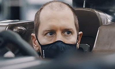 VETTEL IN AN ASTON MARTIN F1 WITH NEW HAIRSTYLE