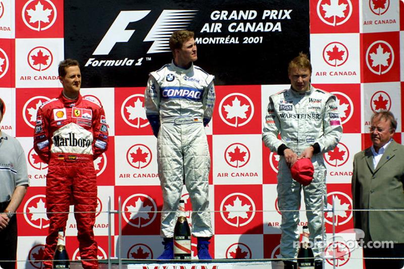 2001 - La fratrie Schumacher au sommet. Pour la première fois dans l'histoire du sport: deux frères signent un doublé. Et si Michael signe la pole devant son cadet Ralf, c'est finalement le pilote Williams qui s'impose devant son frère sur Ferrari.
