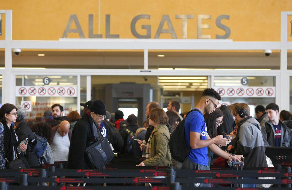 Travelers line up at Atlanta's airport