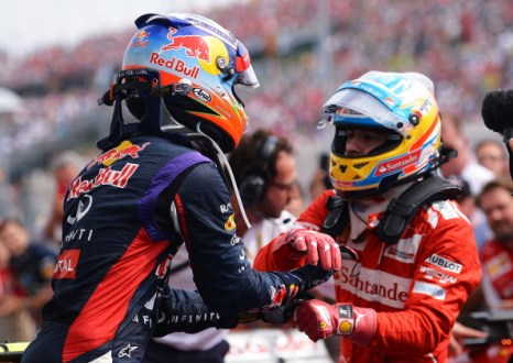 Like a Champ: Alonso congratulates Ricciardo on his stunning win in Hungary. Photo by Getty Images