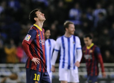 FC Barcelona's Lionel Messi of Argentina, left, reacts after Real Sociedad score.