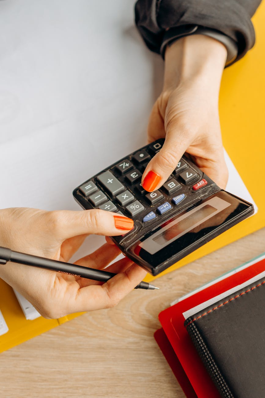a person using a calculator in computing